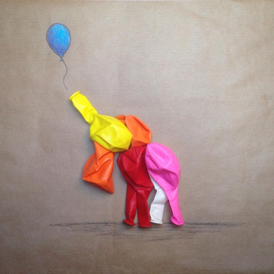 photo of an elephant reaching for a balloon made with party balloons and colored pencils by Kelly Crull