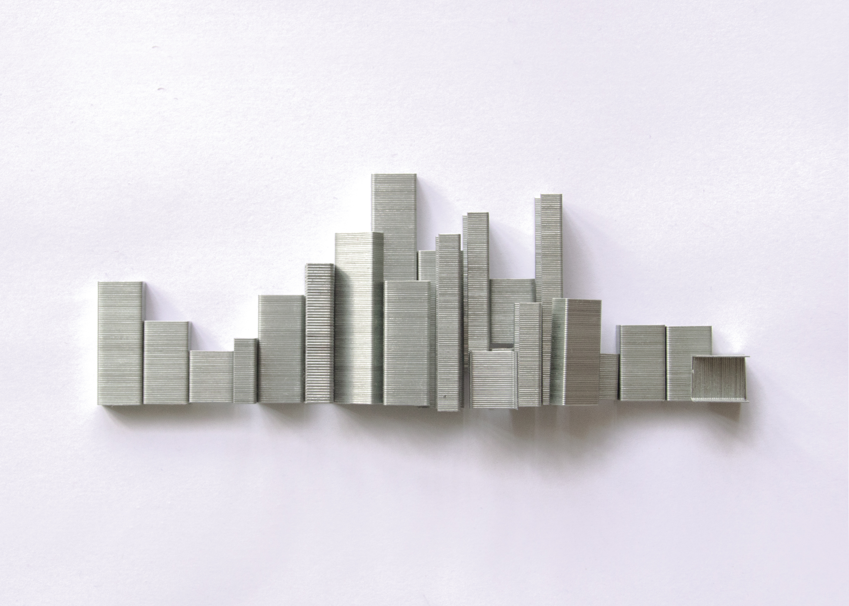 photo of an urban skyline made out of staples by Kelly Crull