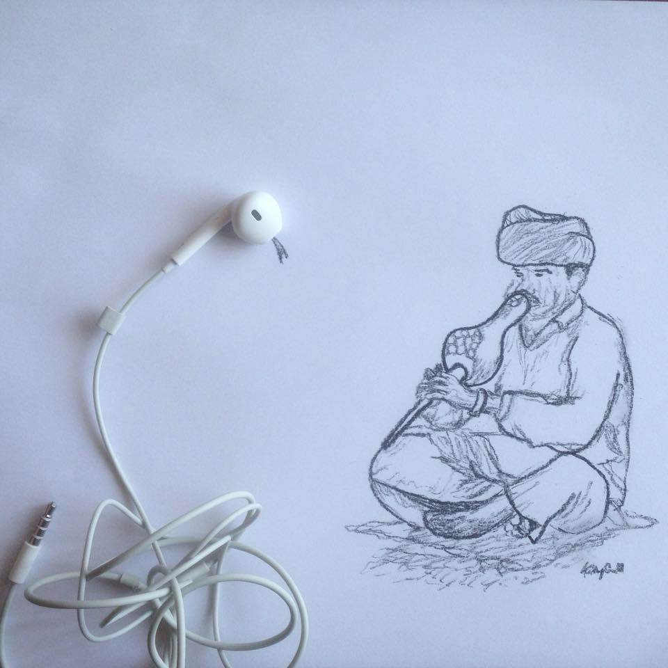 photo of a snake charmer made with Apple earpods and charcoal by Kelly Crull