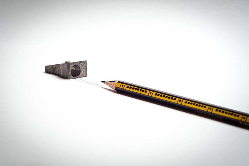 photo of train going into tunnel made out of a pencil and a pencil sharpener by Kelly Crull